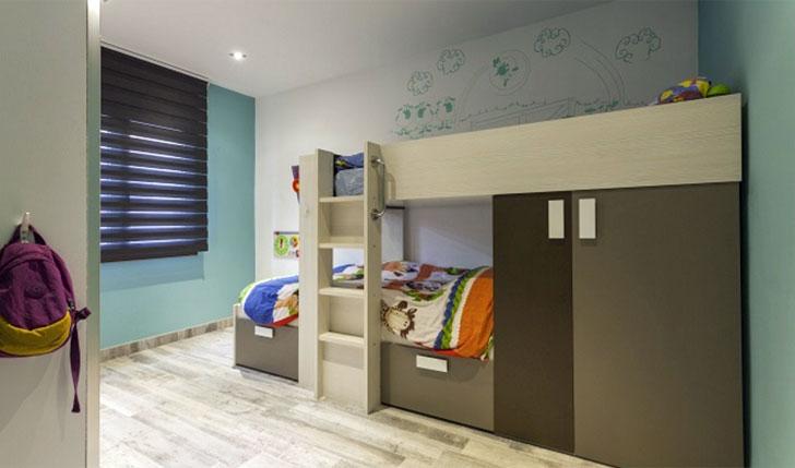 Habitación infantil con zonificación