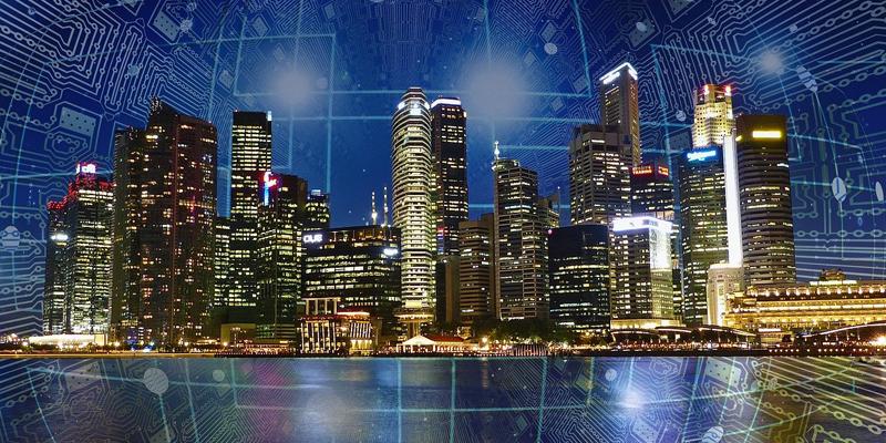 Un conjunto de edificios inteligentes con una red de fondo ilustrando la conectividad de los edificios.